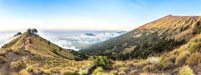Lombok, Panorama mountain view above the cloud and blue sky. Rinjani mountain, Lombok island, Indonesia
