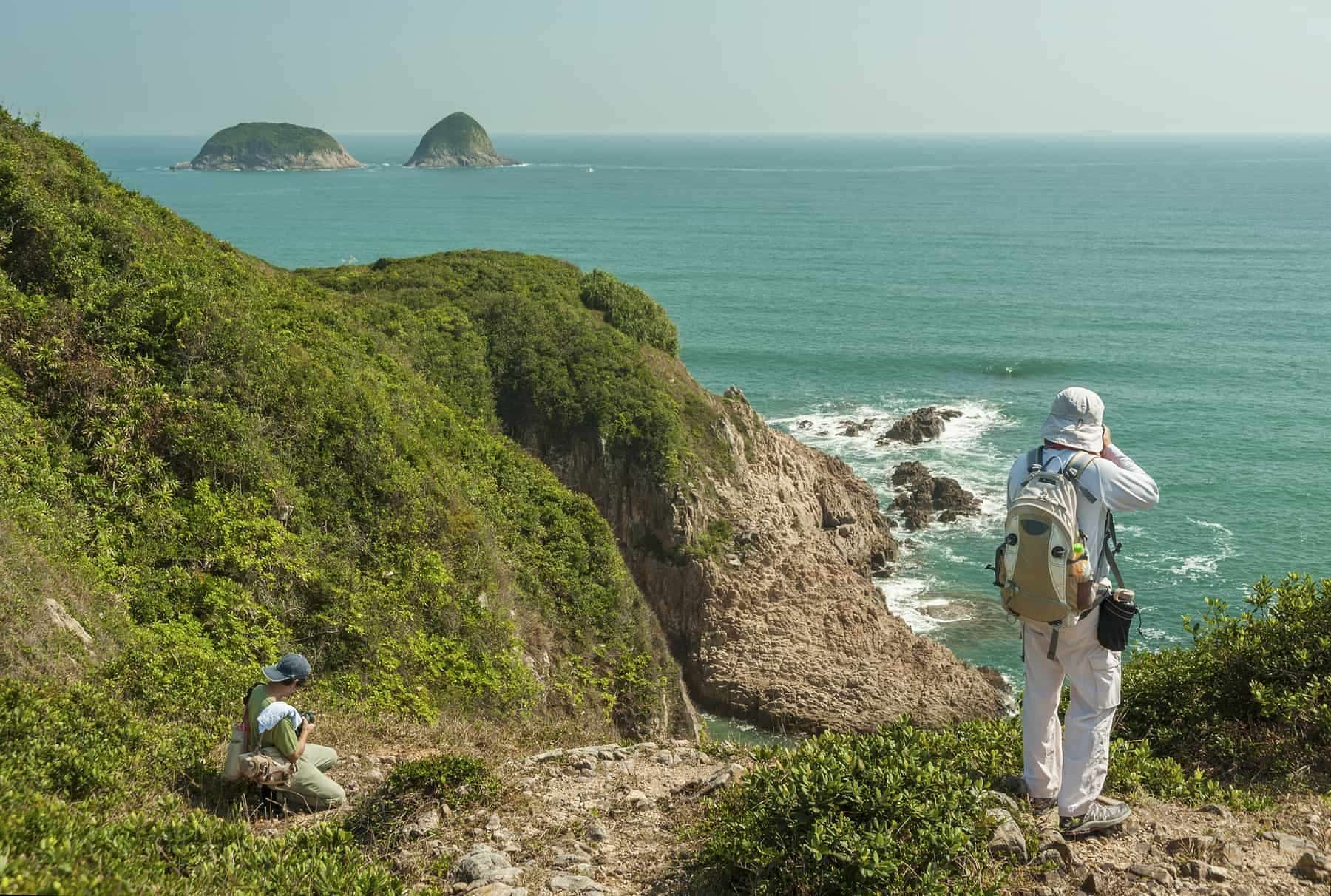 Tourist taking photo in Hong Kong global geopark of china. Sai Kung District, New Territories.