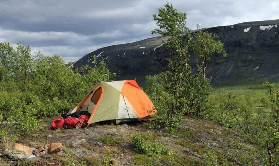"Tent and camping equipment on the Kungsleden trail in Sweden. The Kungsleden (""The King's Trail"" or ""The Trail of Kings"") is one of Sweden's most famous hiking trails and runs for a total of 450 kilometres through Swedish Lapland, 200 kilometres north of the Arctic Circle."