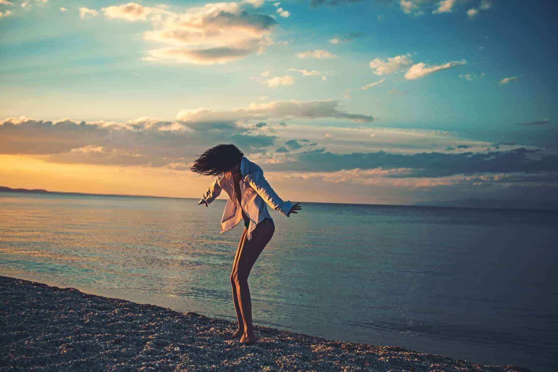 Bahama girl dancing in the sunset