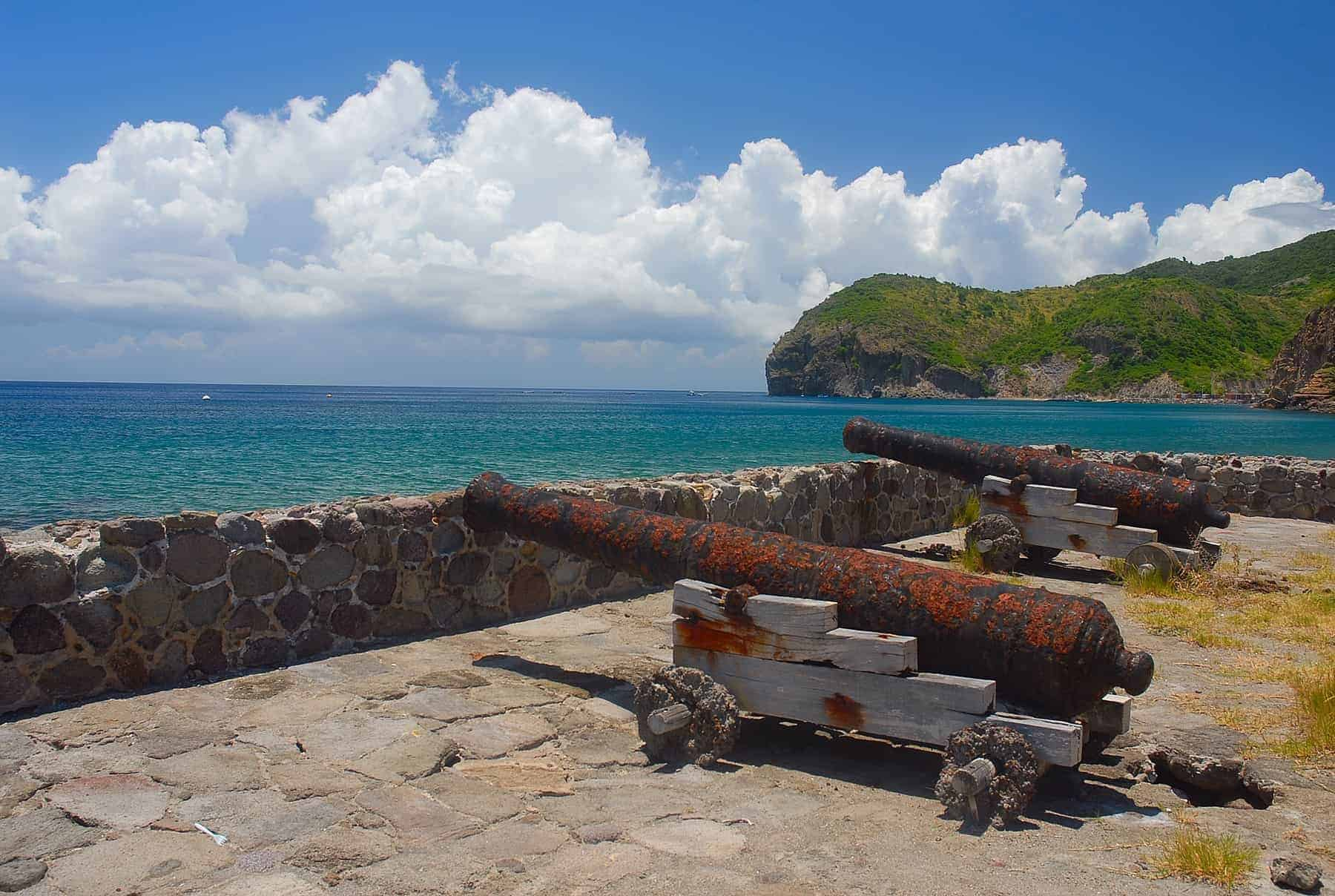 The cannons at Carrs Bay on the Caribbean island of Montserrat in the West Indies. Several cannons are aimed towards the smaller island of Redonda at the remnants of a fort which stood guard over Montserrat centuries ago.