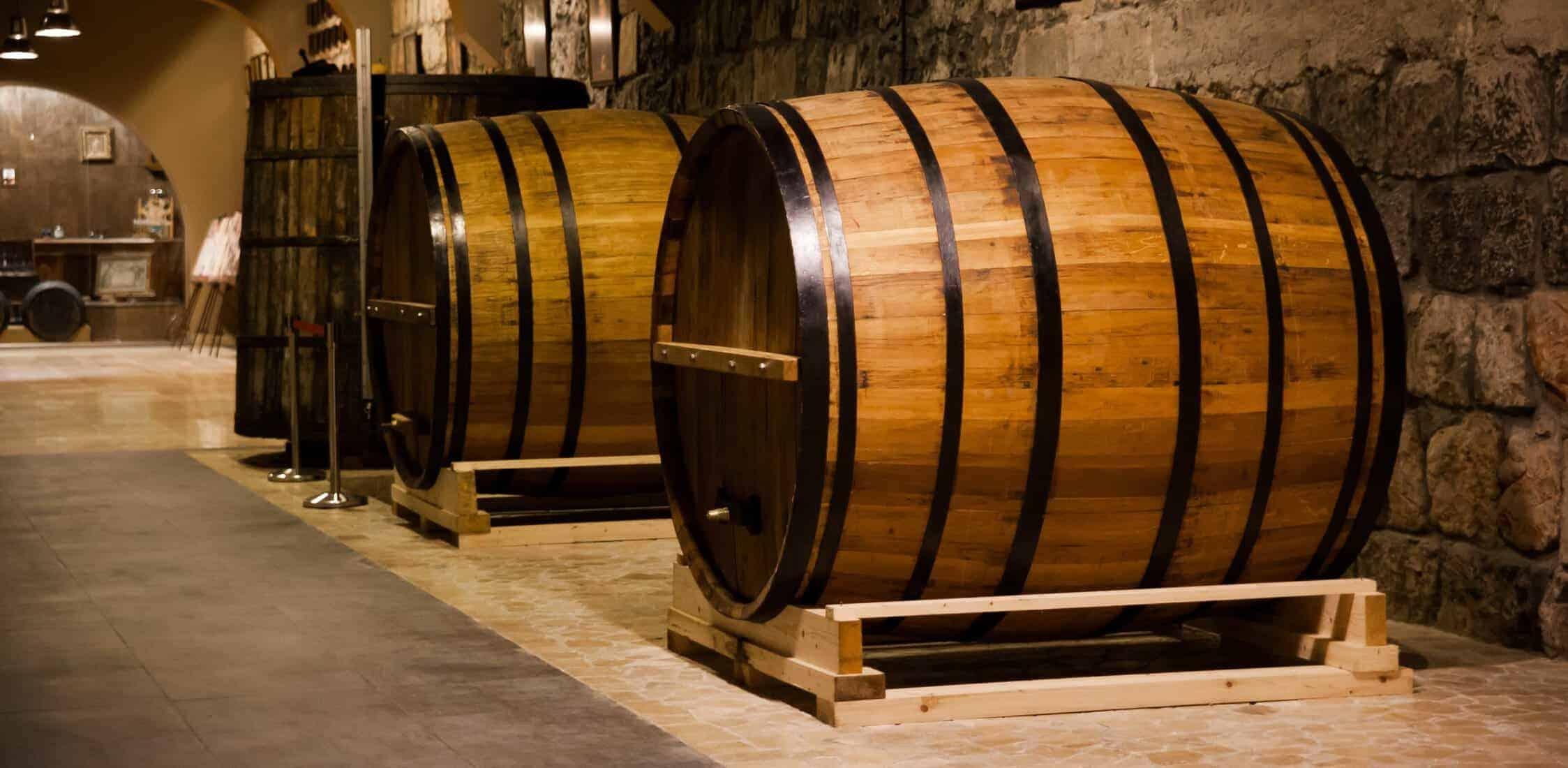 Cognac barrels in cellar old factory in Yerevan Armenia