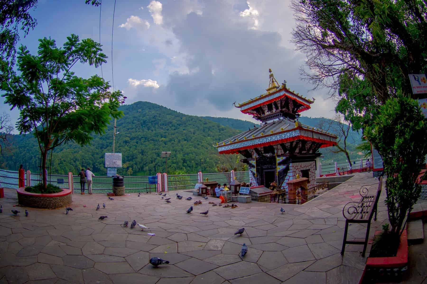 POKHARA, NEPAL - People walking around of Tal Barahi Temple, located at the center of Phewa Lake, is the most important religious monument of Pokhara.