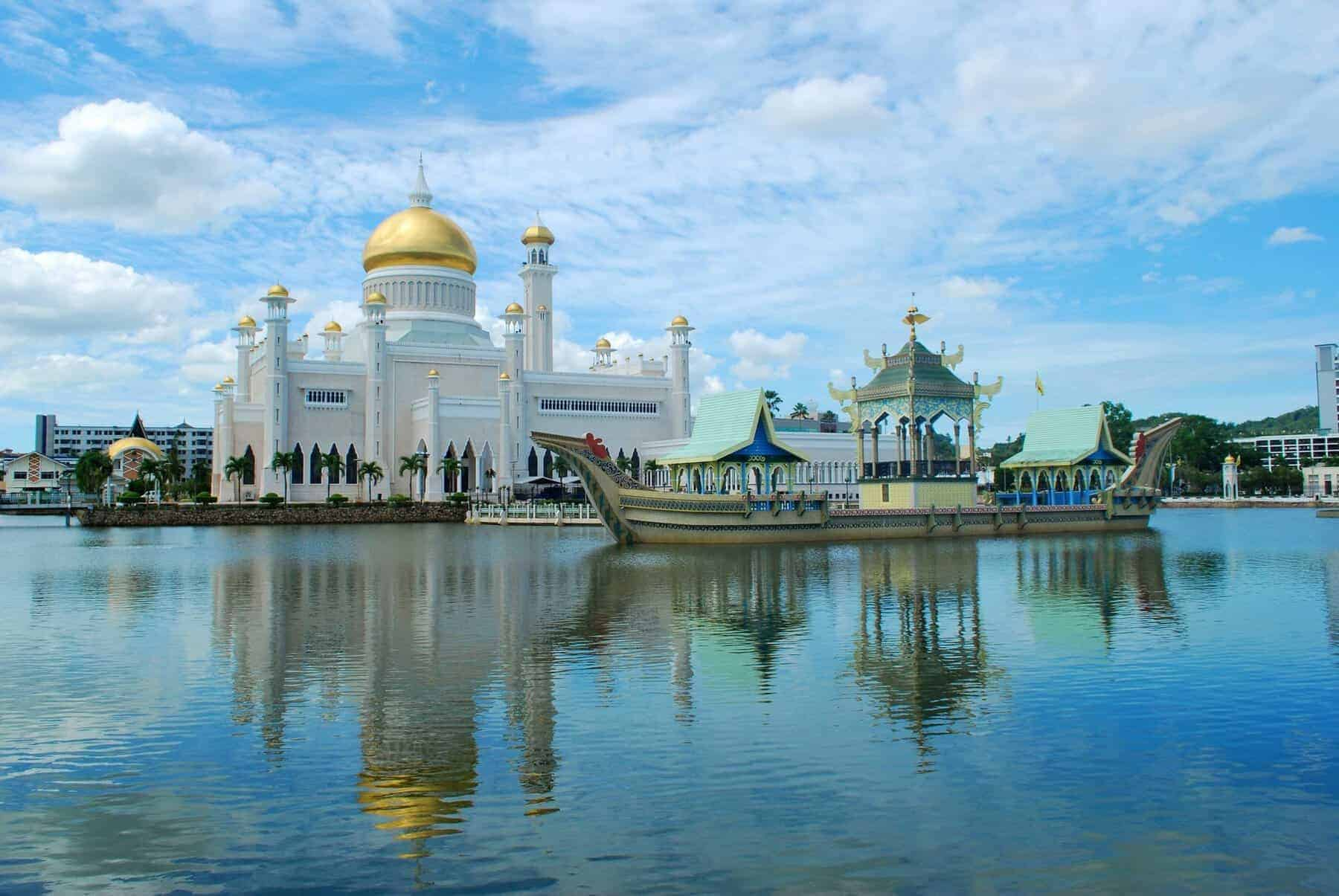 The white golden-domed Sultan Omar Ali Saifuddien Mosque in Bandar Seri Begawan, the capital of Brunei, on the island of Borneo.