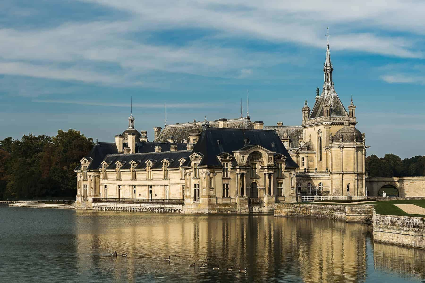 Chateau de Chantilly and the geese crossing the pond