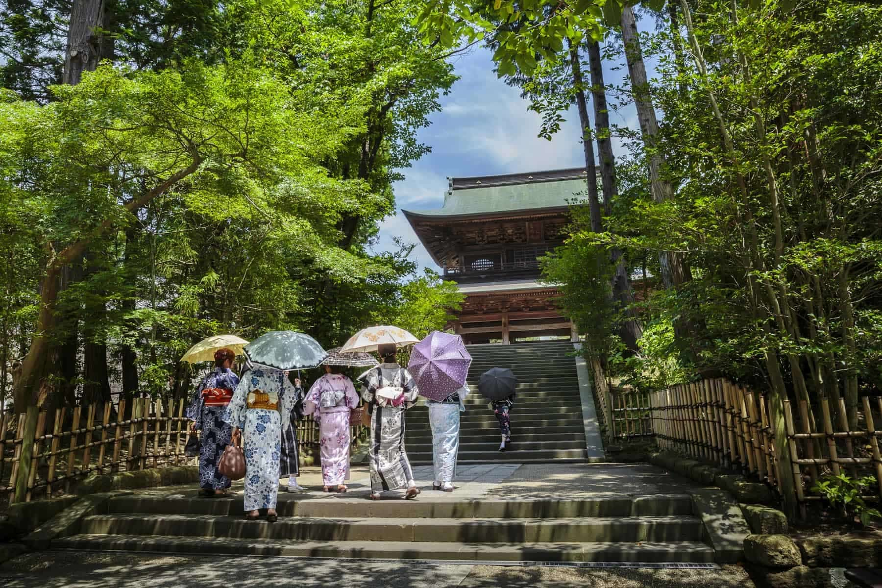 Women in traditional kimonos in front of a temple in Kamakura, Kanagawa prefecture, Japan.