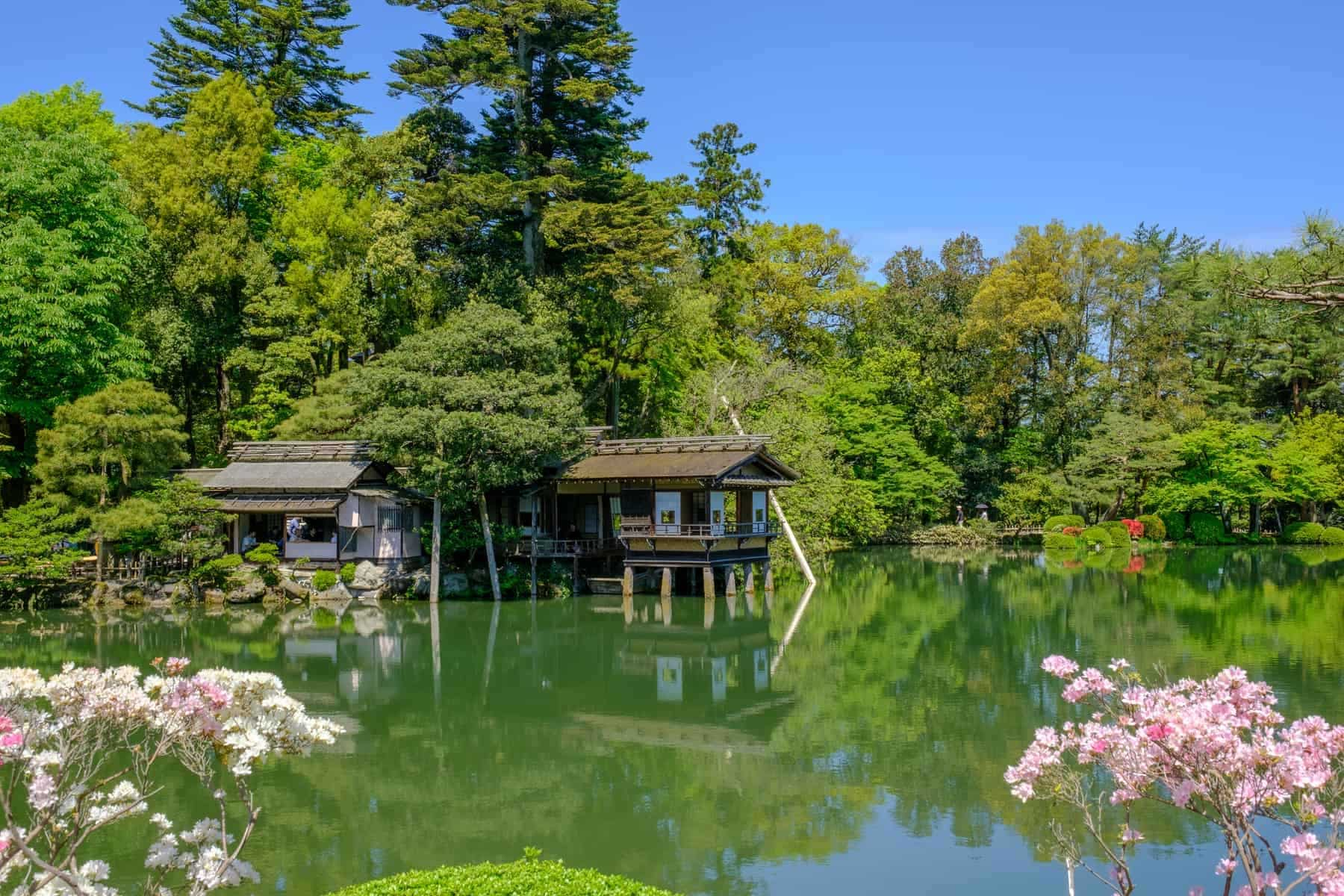 Pond and tea house in Kenrokuen, a japanese garden in Kanazawa, Ishikawa prefecture, Japan