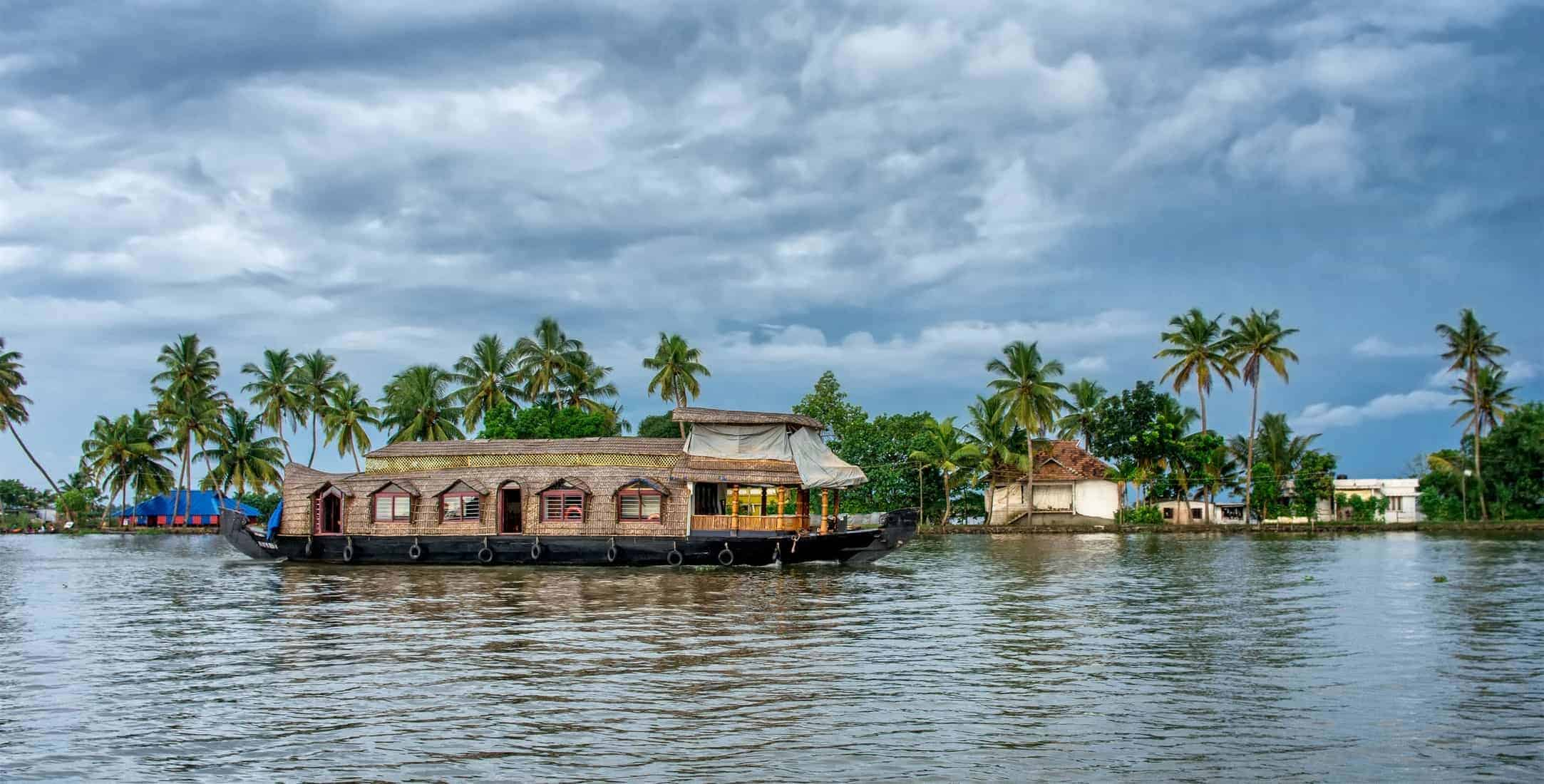 Traditional Indian houseboat near Alleppey on Kerala backwaters, India. Panoramic view