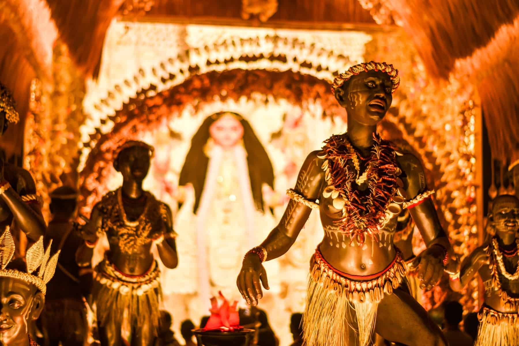 KOLKATA , INDIA SEPTEMBER 26, 2017 - Decorated art and craft sculptures of Traditional tribal Santal or Santhal ethnic group dancers wear traditional clothing in a famous Durga Puja pandal.