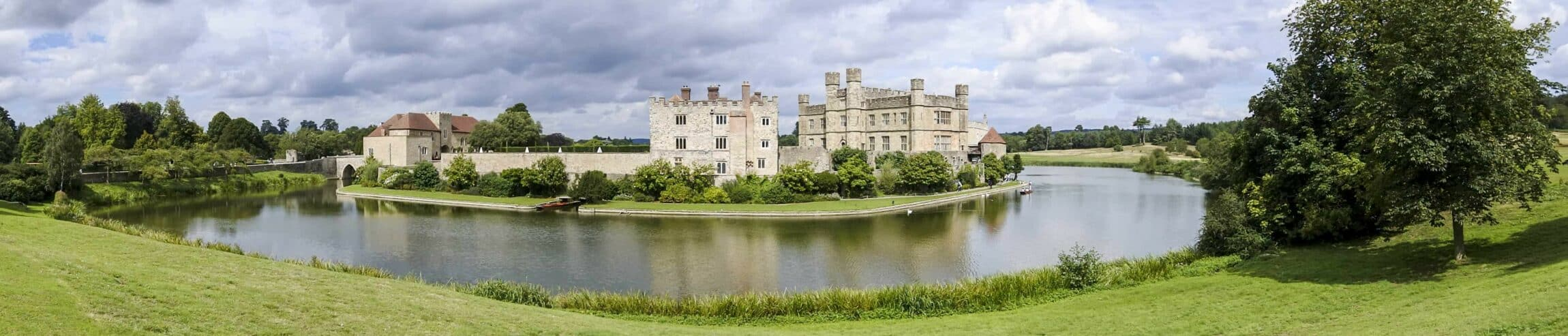 LEEDS CASTLE - Panorama of Leeds castle with the moat in the foreground