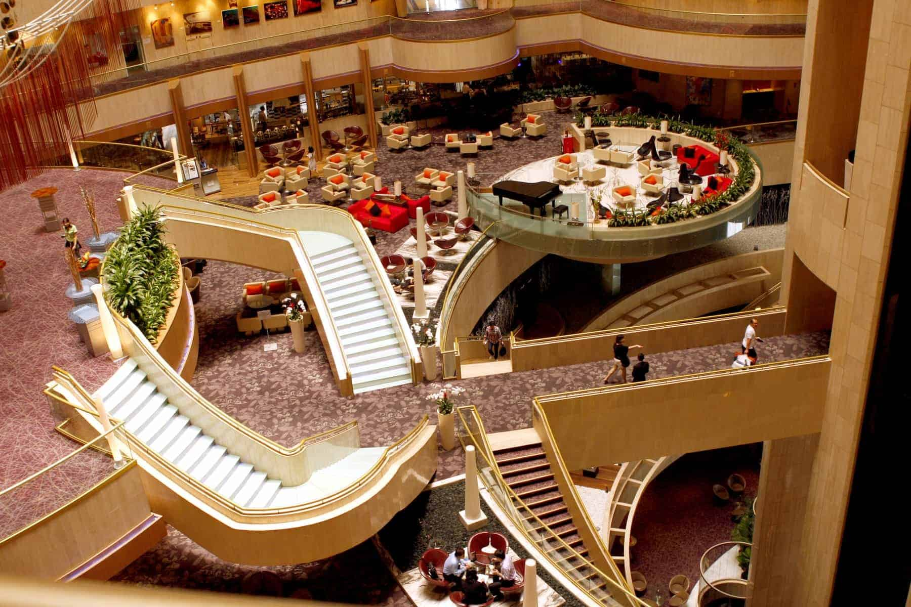 The huge interior hall and stairs of the Mandarin Oriental Hotel in Singapore in south east Asia.
