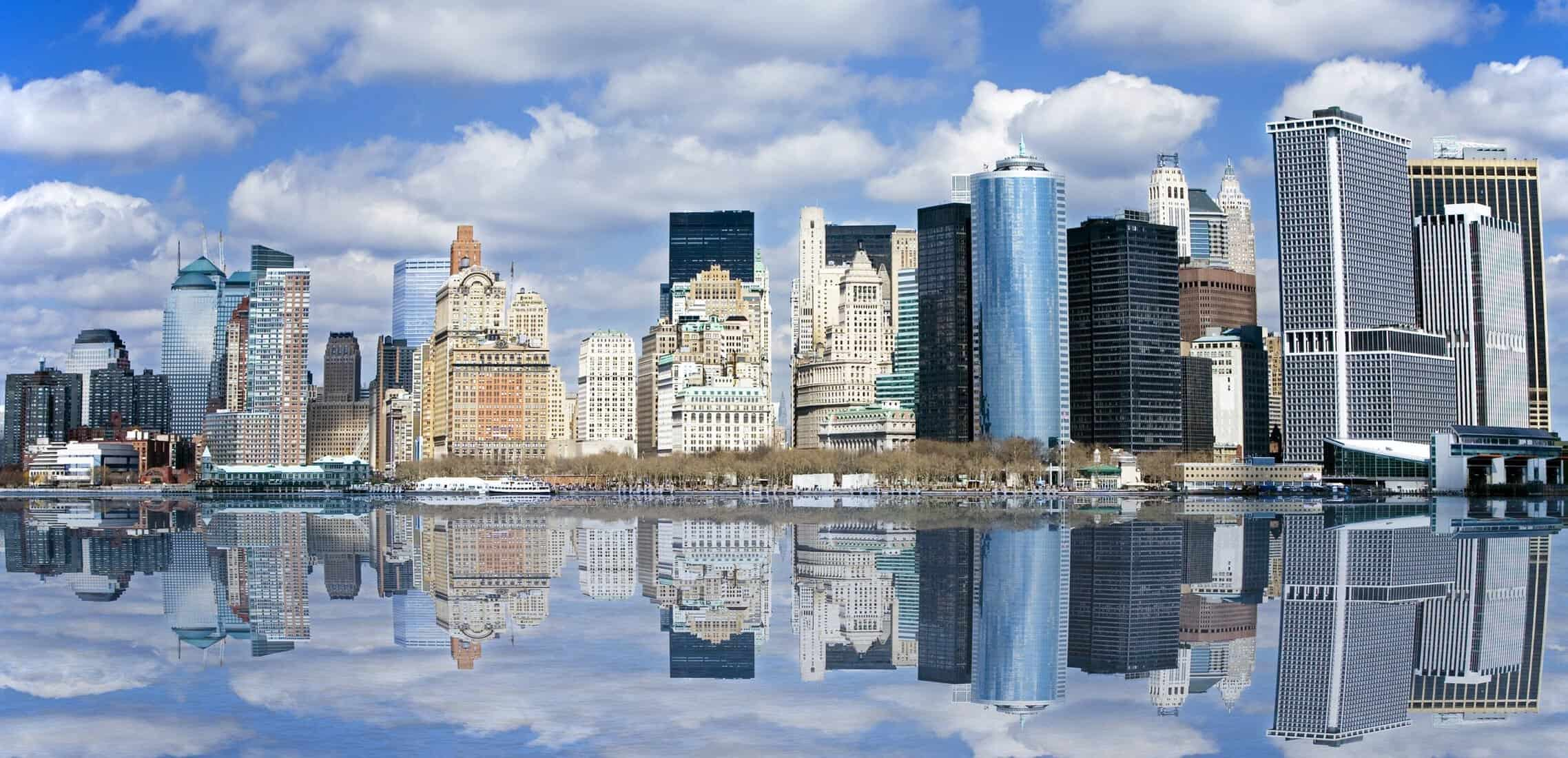 Lower end of Manhattan with reflection as seen from New York Harbor. Top 15 places to visit in the US