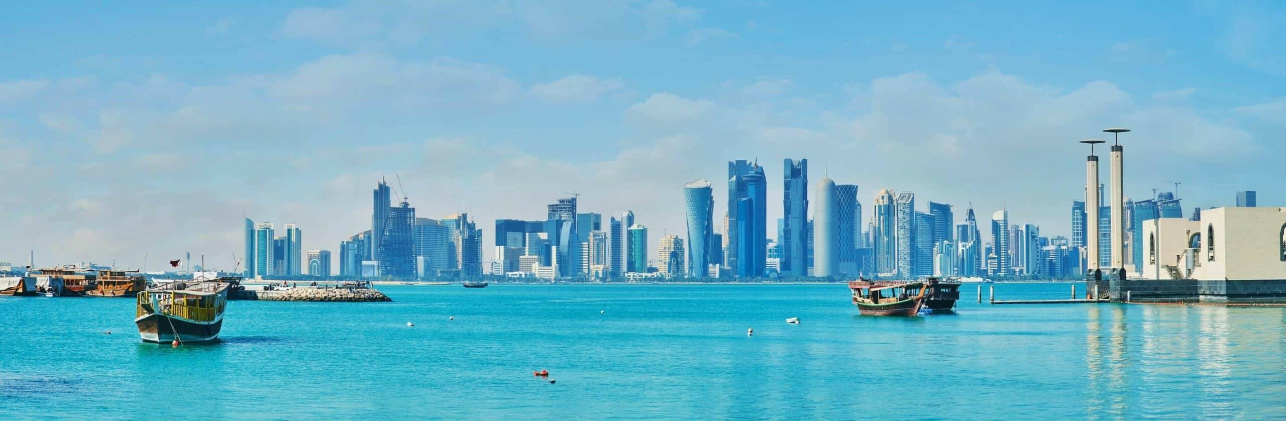 The seaside view on futuristic skyscrapers of West Bay from the Corniche promenade, Doha, Qatar.