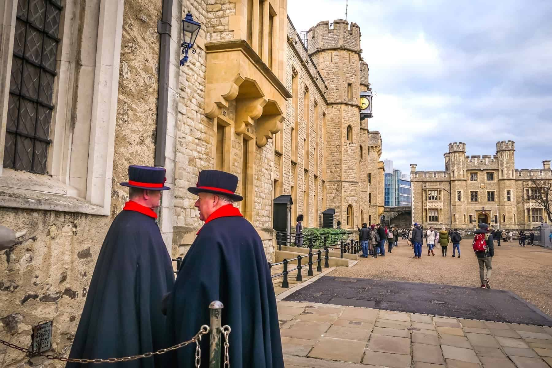 Two Yeomen Warders at Tower of London. Yeomen Warders also known as Beefeaters are ceremonial guardians of the Tower of London.Her Majesty's Royal Palace and Fortress the Tower of London in London.