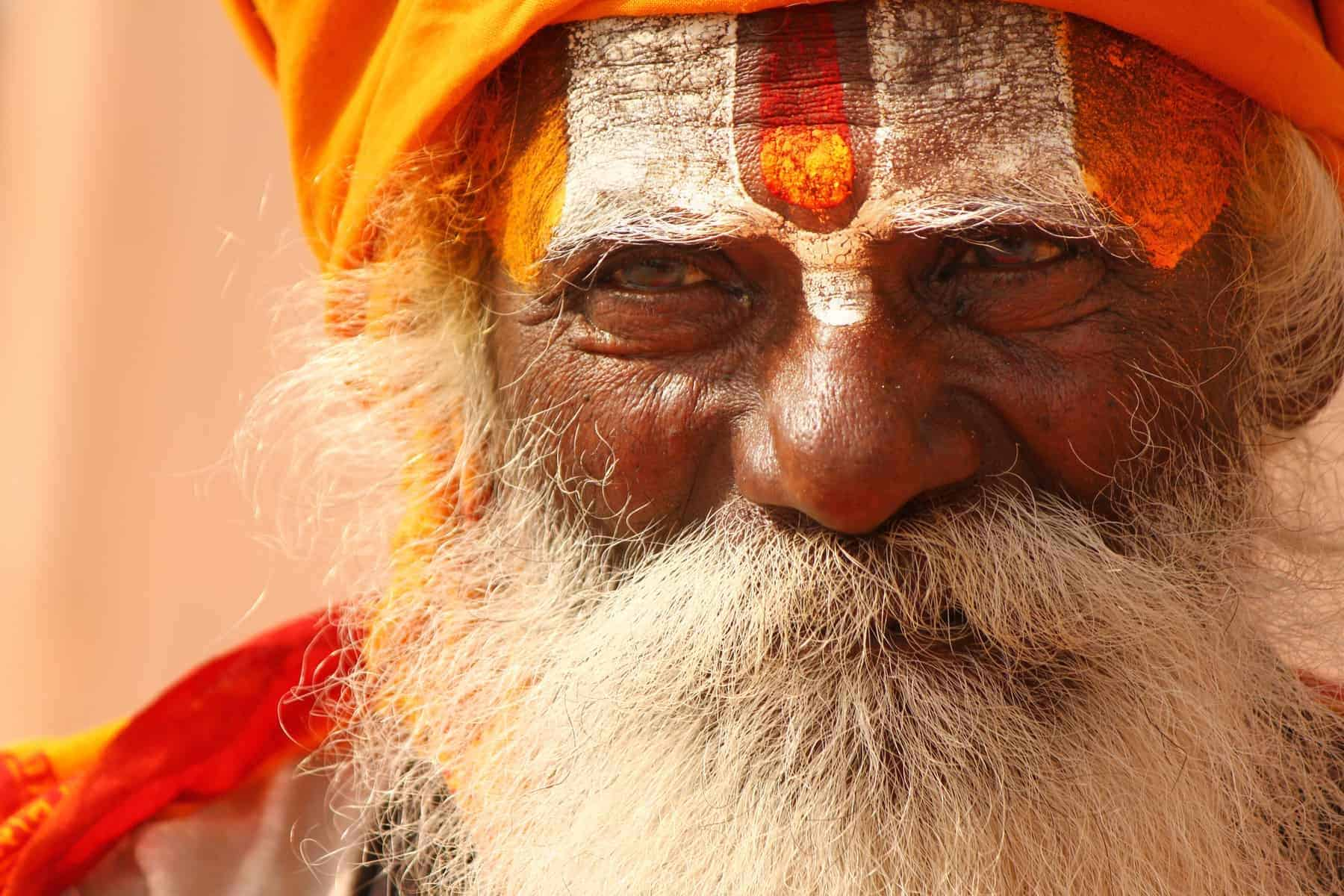 A Hindu monk, painted his forehead with holy colors on the bank of river Ganga, at Varanasi, India. It is said that Varanasi is the oldest living city on earth. they are known as sadhus. Sadhus engage in a wide variety of religious practices. Some practice extreme asceticism while others mainly focus on praying, chanting or meditating.