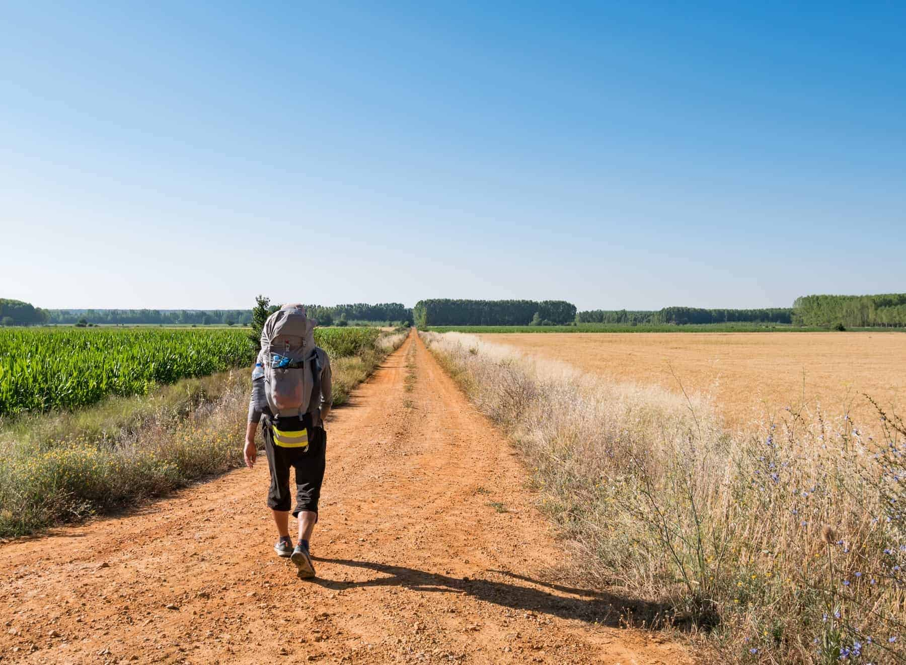 Lonely Pilgrim with backpack walking the Camino de Santiago in Spain