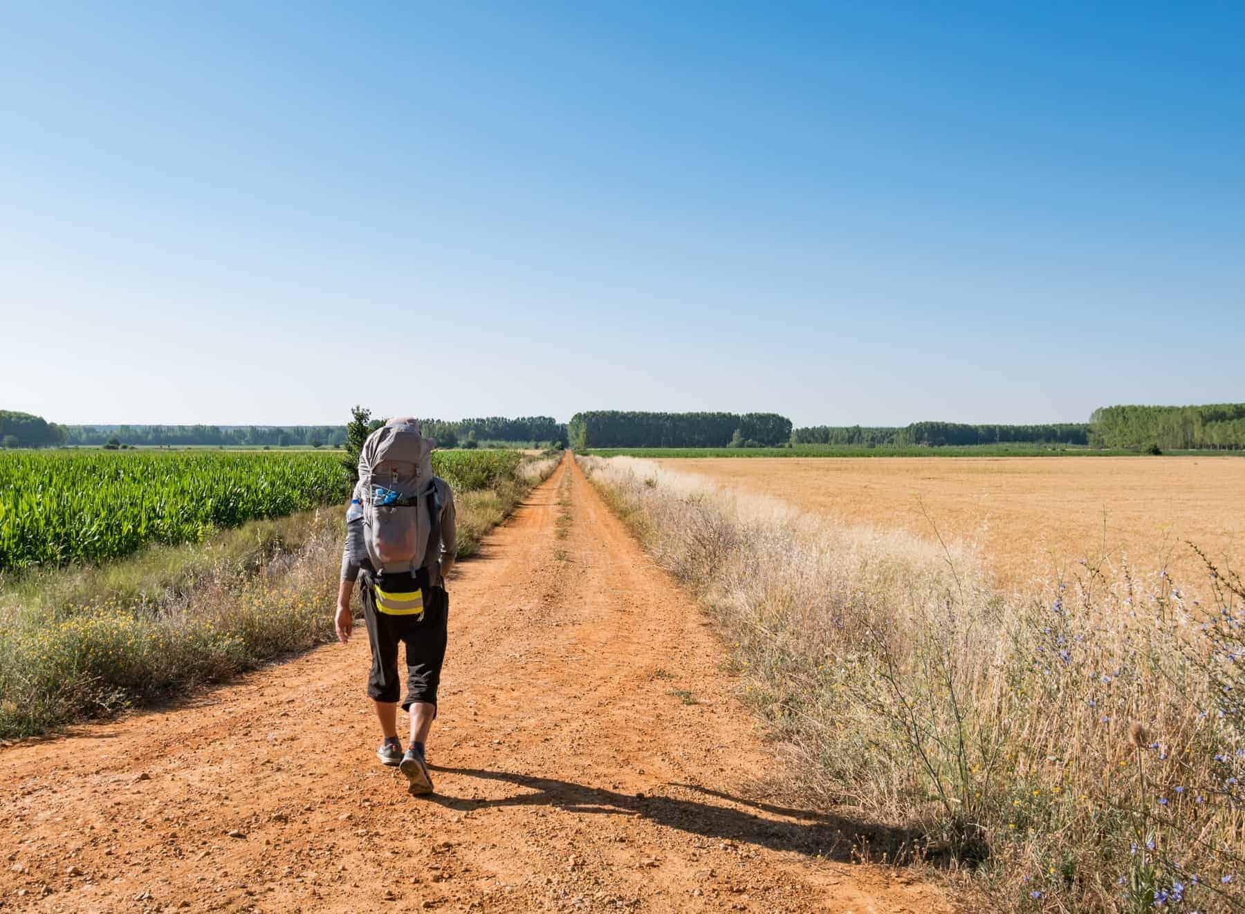 Lonely Pilgrim with backpack walking the Camino de Santiago in Spain
