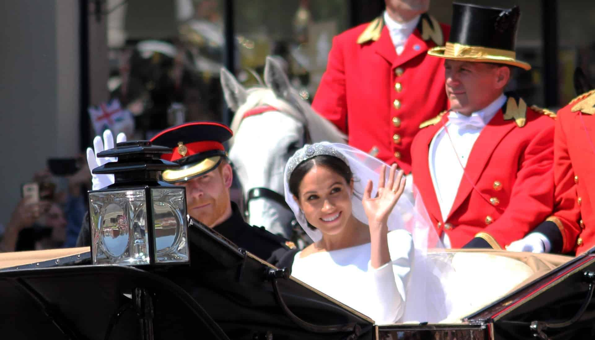 Prince Harry & Meghan Markle, Windsor, Uk - 19/5/2018: Prince Harry and Meghan Markle wedding procession through streets of Windsor then back the Windsor Castle Meghan waving to crowd in Givenchy dress.