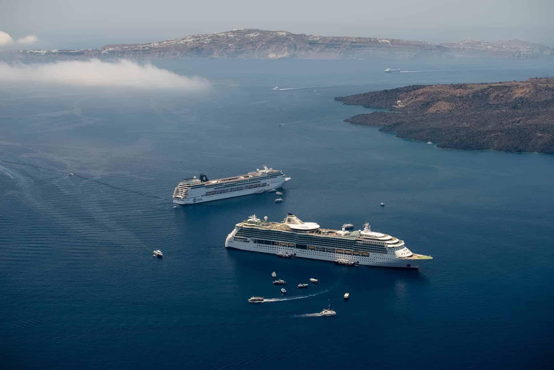 Cruising ship on Santorini island in summer time on Aegean sea.