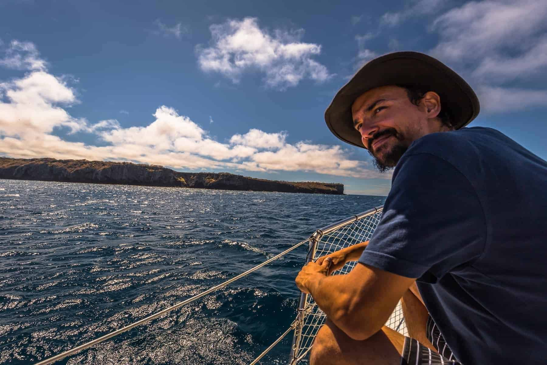 Galapagos Islands - August 24, 2017: Boat riding on the coast of Santa Cruz island, Galapagos Islands, Ecuador.