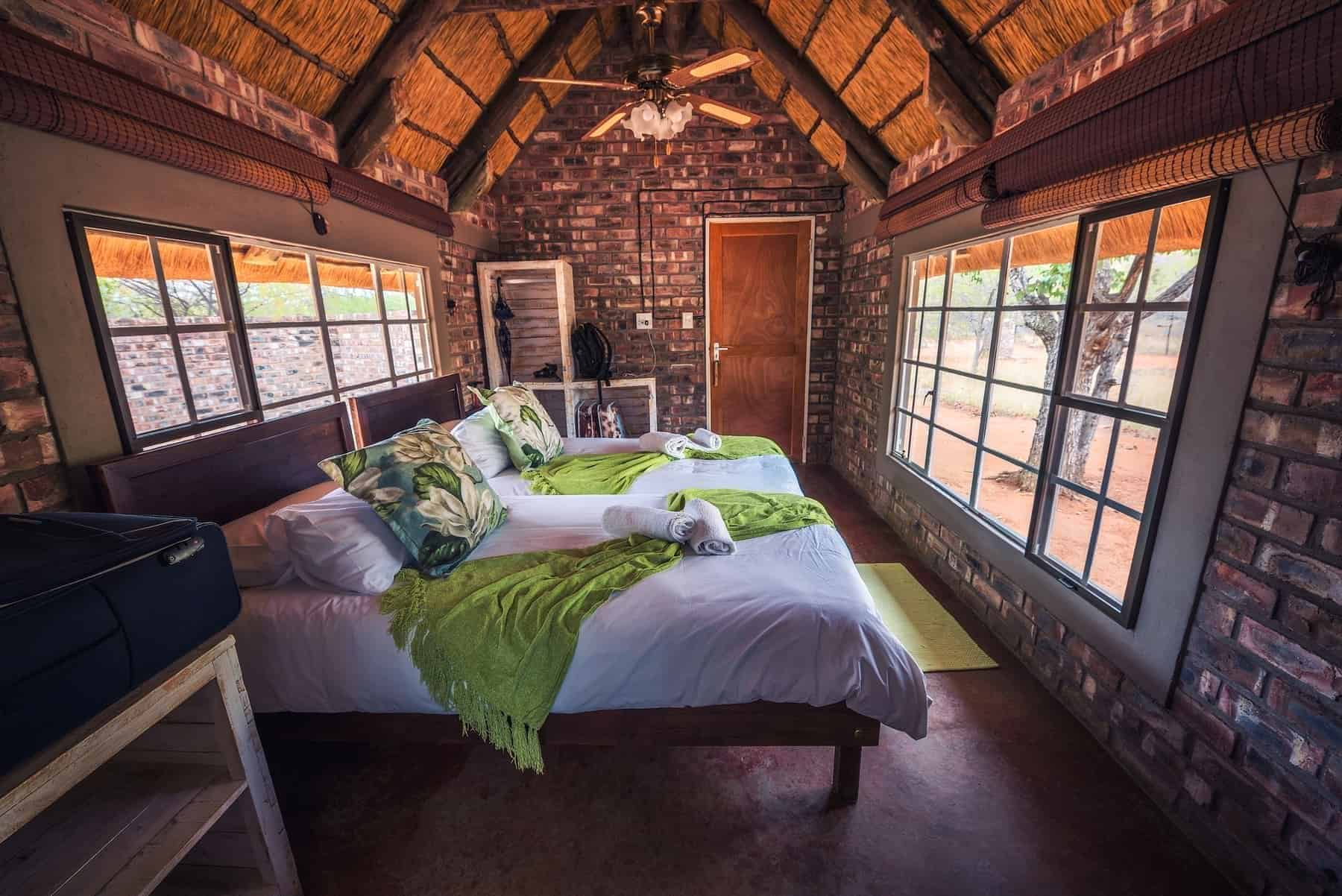 Kamanjab, Namibia - March 30, 2019 : Chalet interior of the Kaoko Bush Lodge in Kamanjab. This desert lodge is located near the Galton Gate of Etosha National Park.