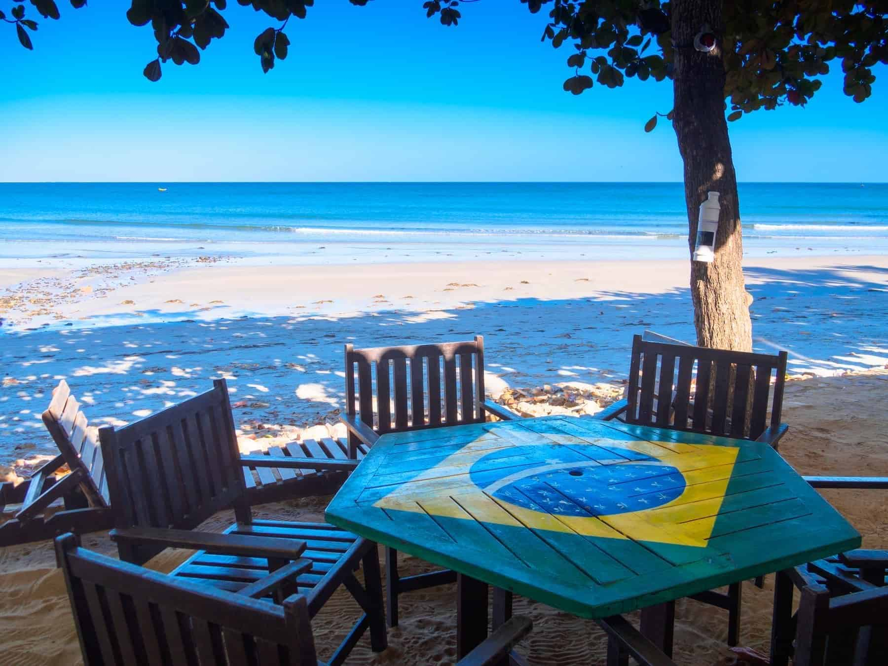 Main beach of the village with table with the flag of Brazil - Jericoacoara National Park - State of Ceara - Brazil