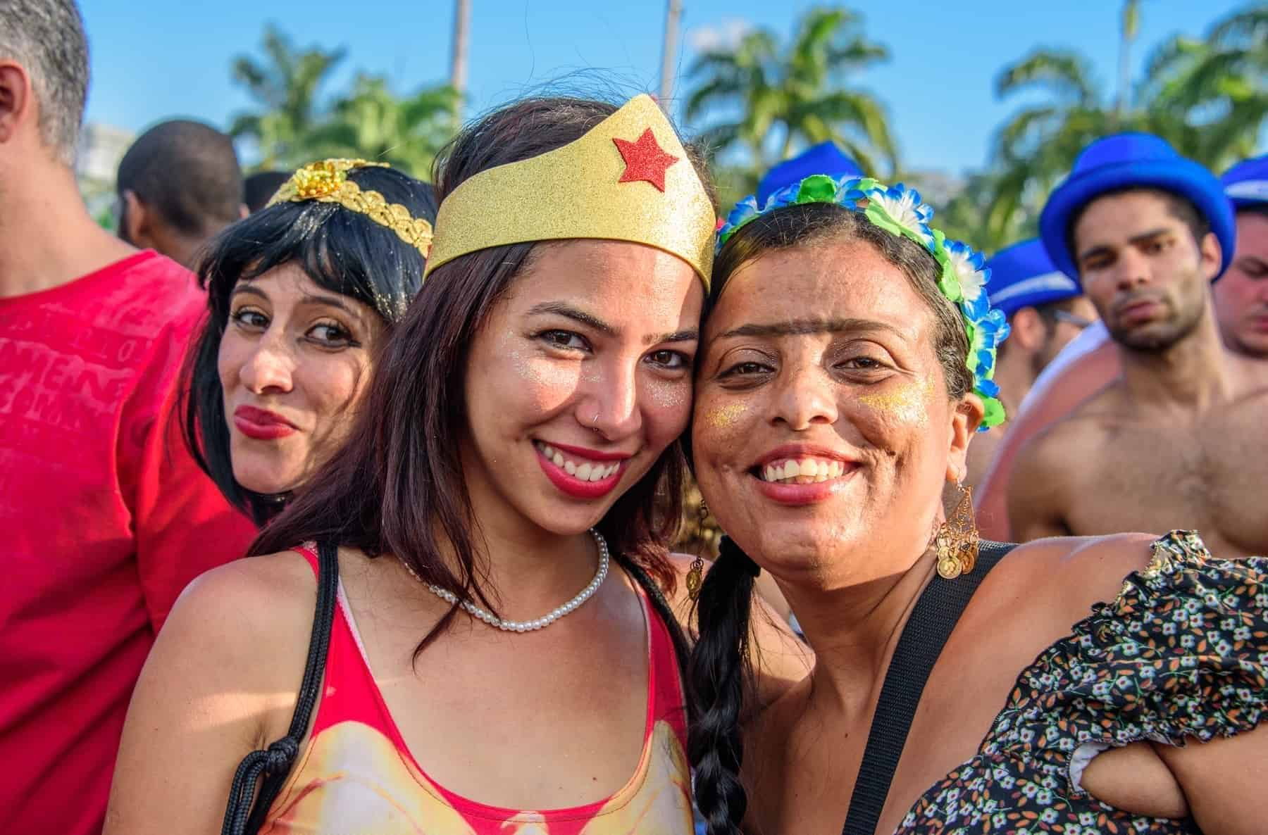 RIO DE JANEIRO, BRAZIL Young women wearing costumes of Wonder Woman and Frida Kahlo with unibrow having fun at Bloco Orquestra Voadora in Flamengo Park, Carnaval 2017