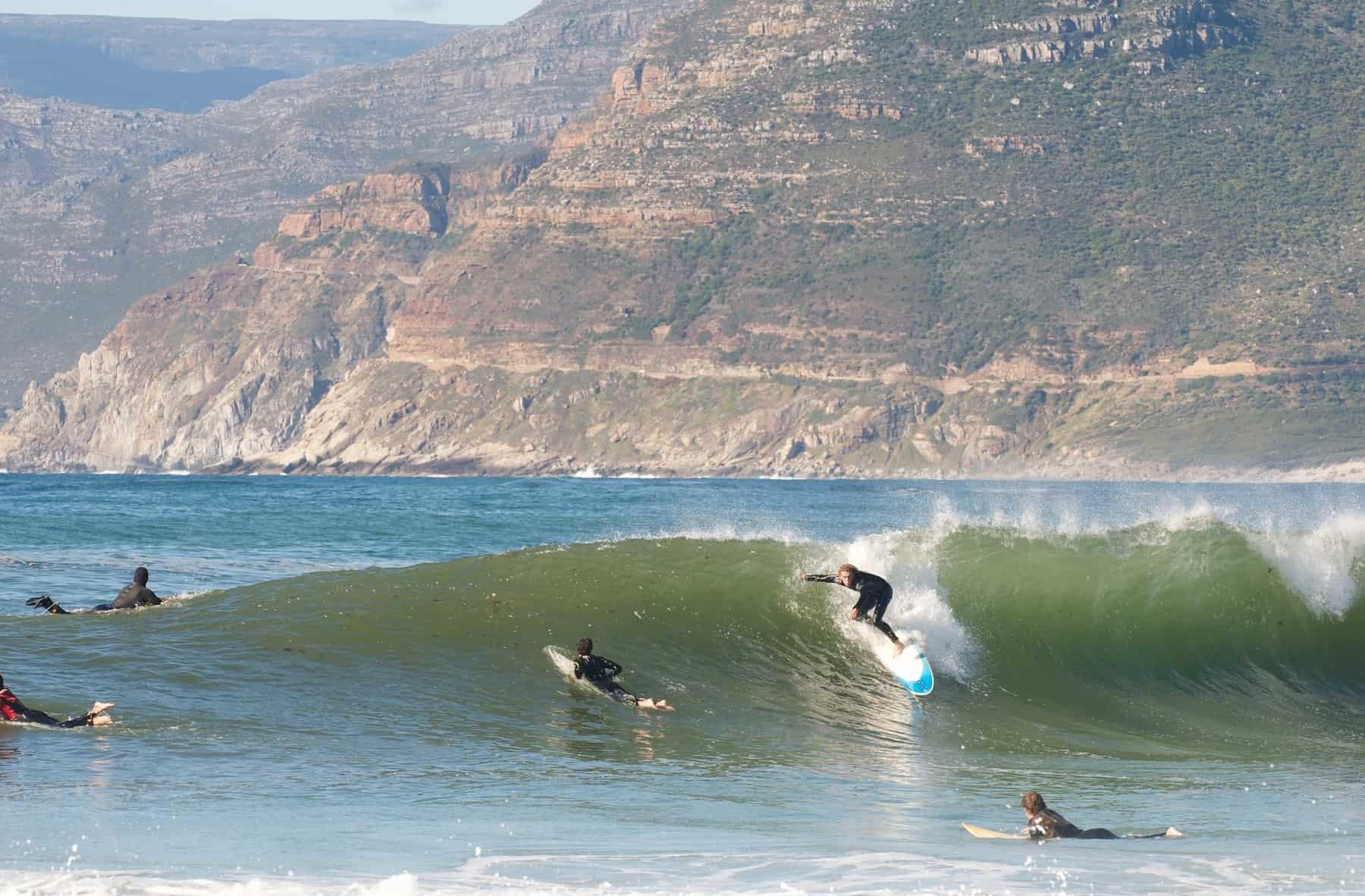 Surfer at popular surfing break,Long Beach, Kommetjie,Cape Town