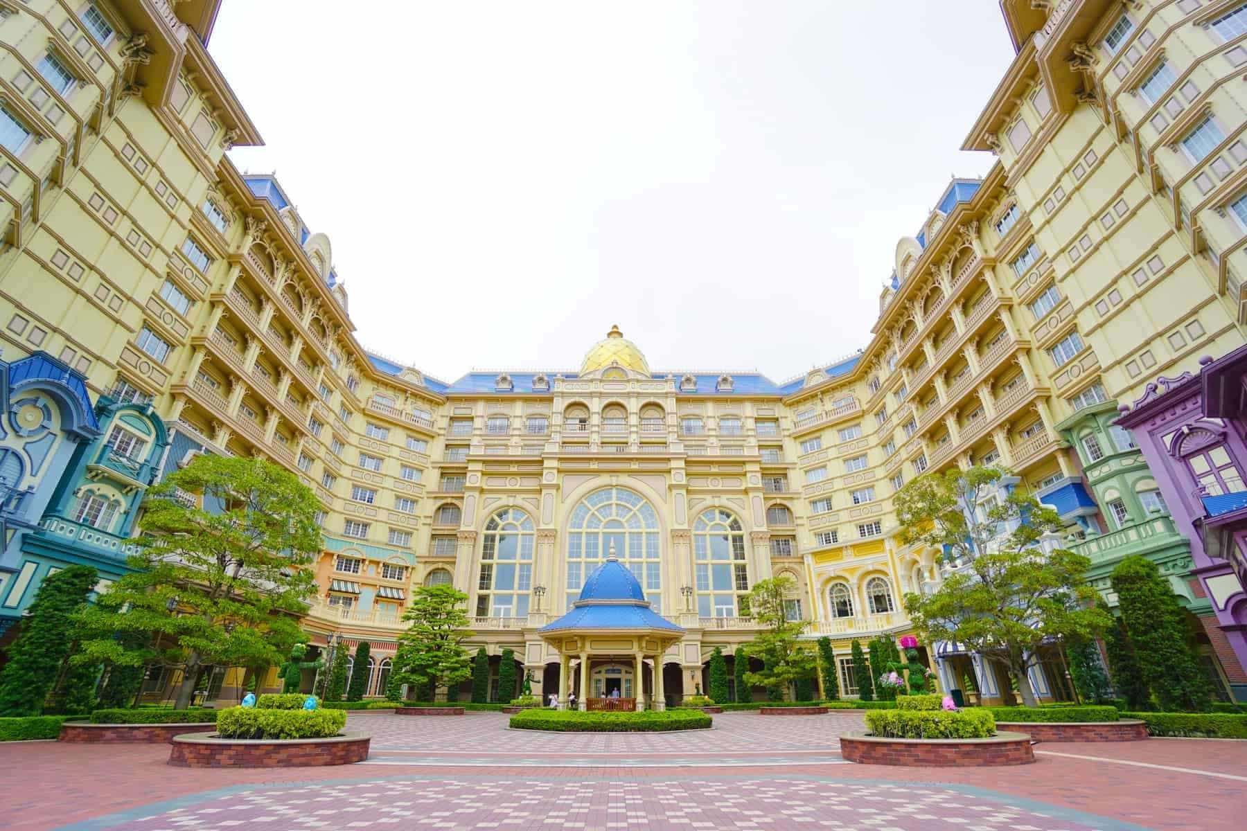 The Tokyo Disneyland Hotel located in front of the Tokyo Disneyland park with the Tokyo Disneyland station of the Disney Resort Line monorail system in Chiba, Japan