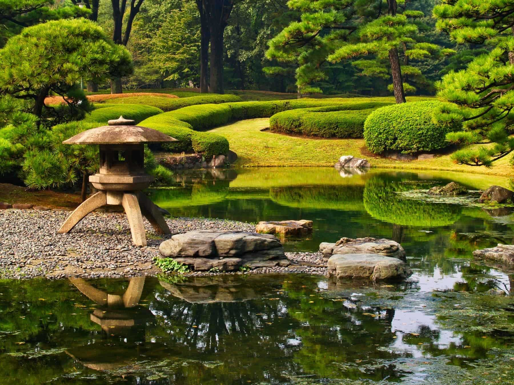 Traditional Japanese formal gardens, including water feature, sculptured trees and hedges, Imperial Palace Gardens,Kōkyo Higashi-gyoen, Tokyo, Japan.