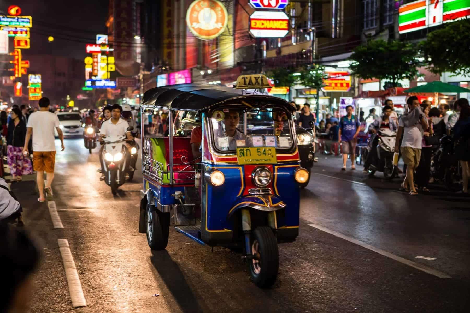 Tuk - tuk on Chinatown street Bangkok, Thailand