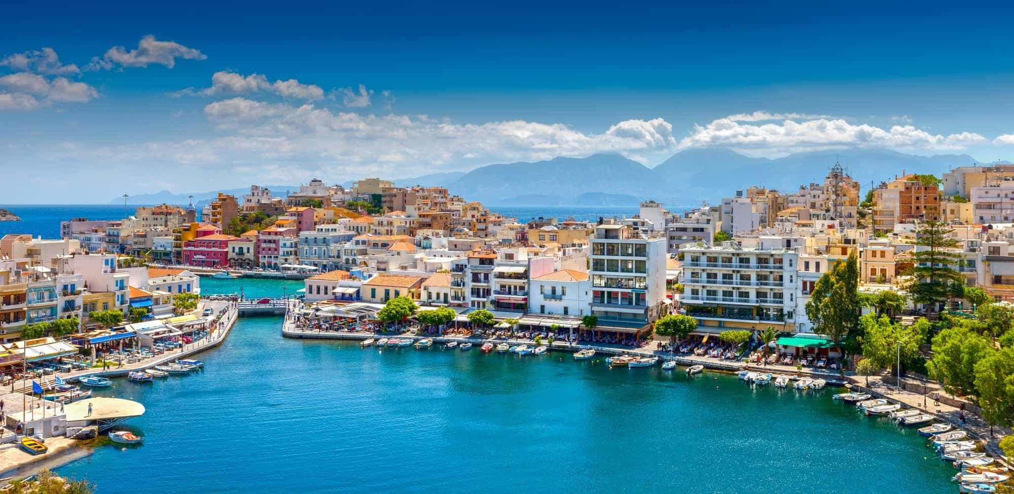 Agios Nikolaos. Agios Nikolaos is a picturesque town in the eastern part of the island Crete built on the northwest side of the peaceful bay of Mirabello