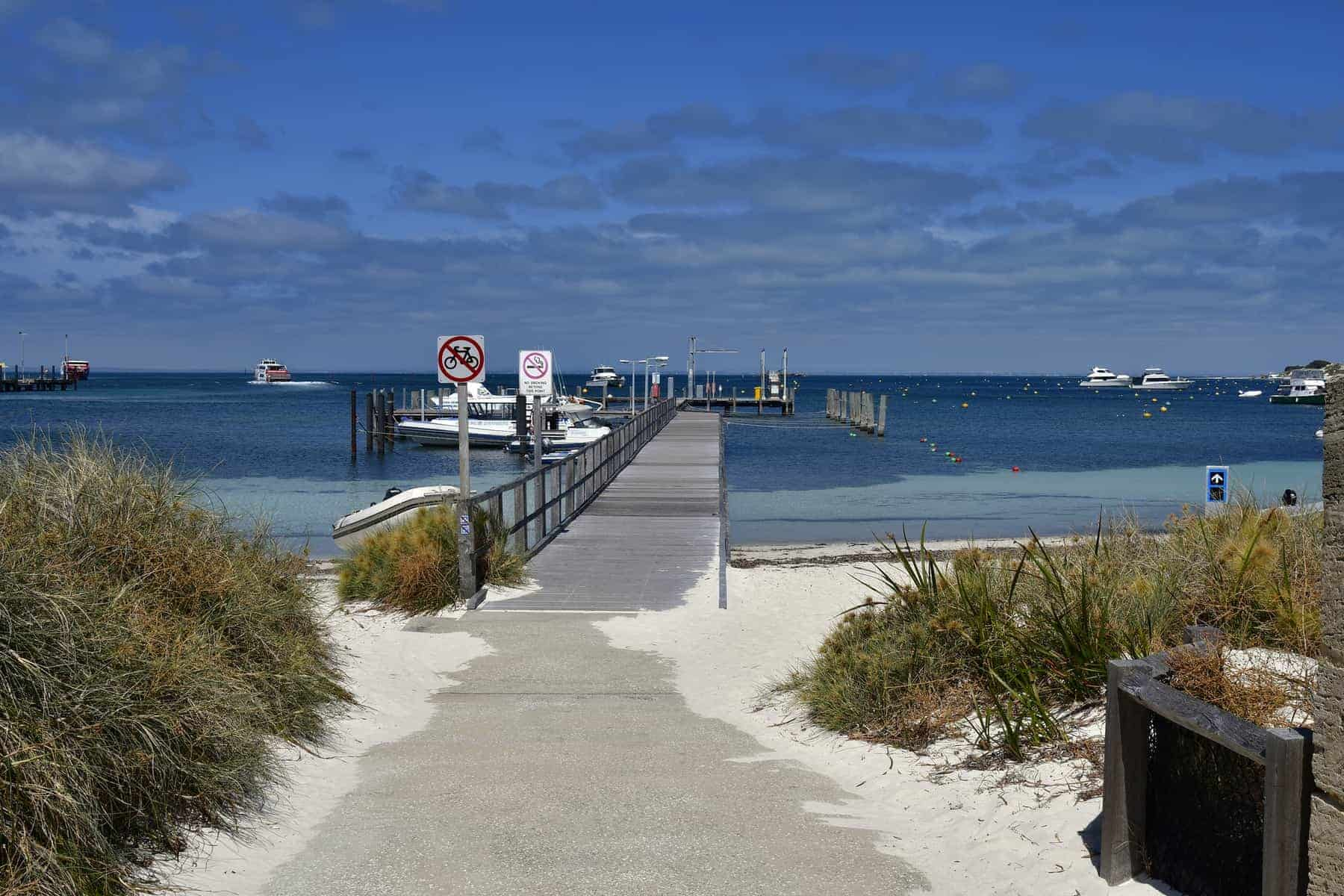 Ferry to Perth and yachts on jetty in Rottnest Island