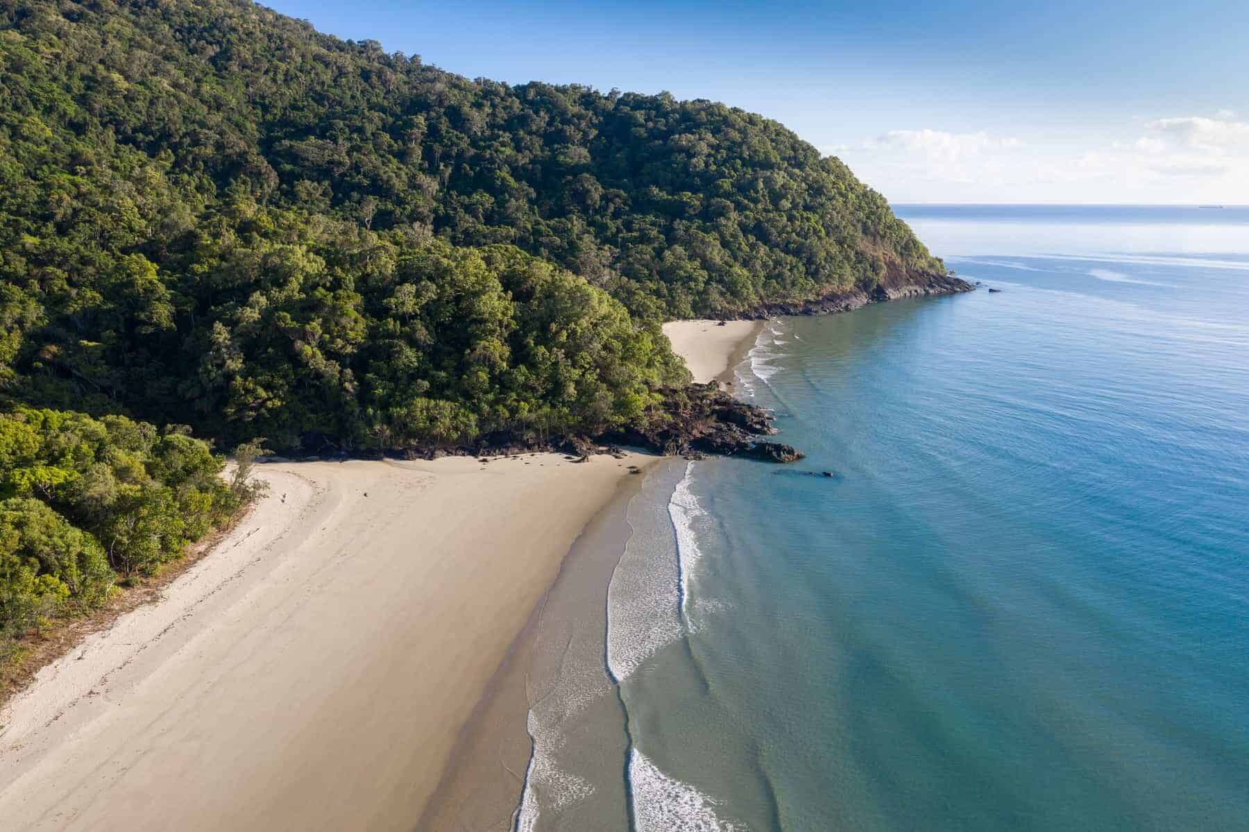 Noah Beach located on the Daintree coast north of Cairns. The rainforest meets the ocean in this pristine section of coastland in Queensland Australia.