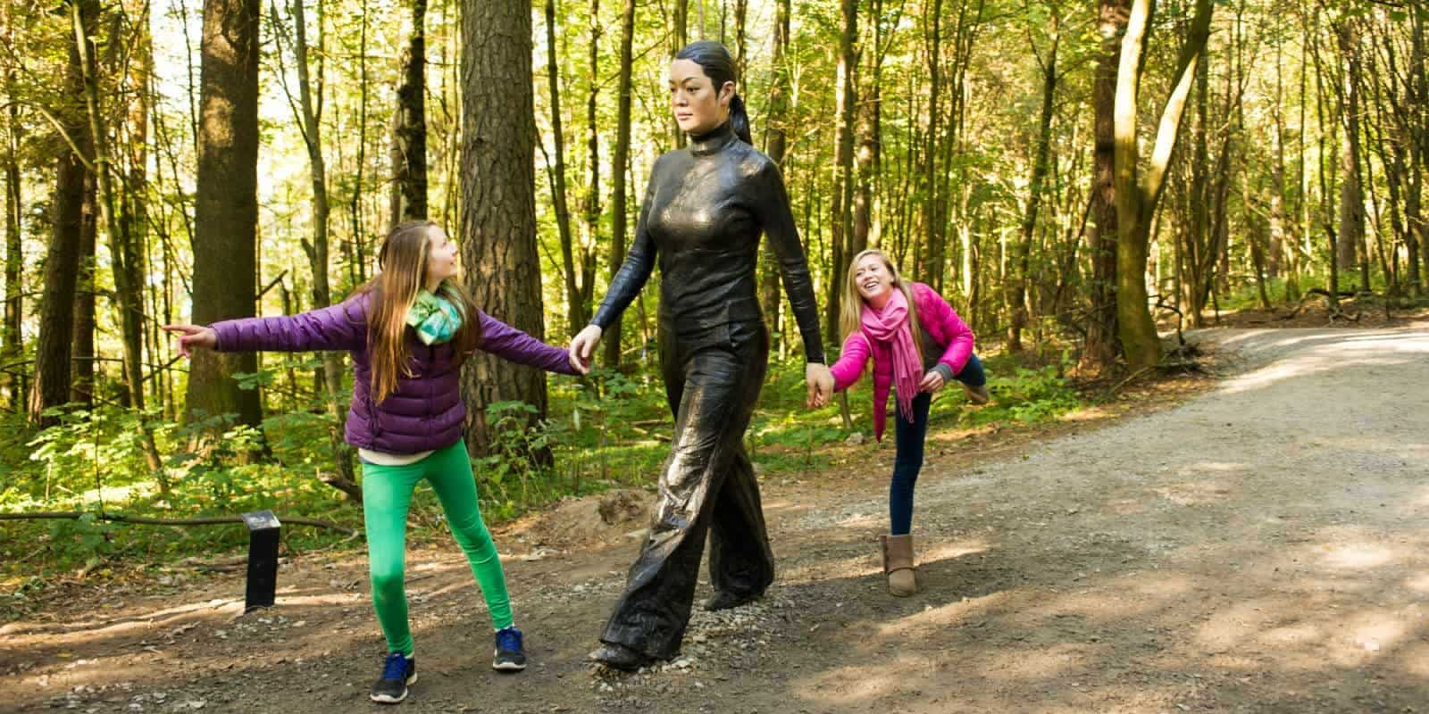 Asian Woman with children in Ekeberg Art park, Oslo, Norway