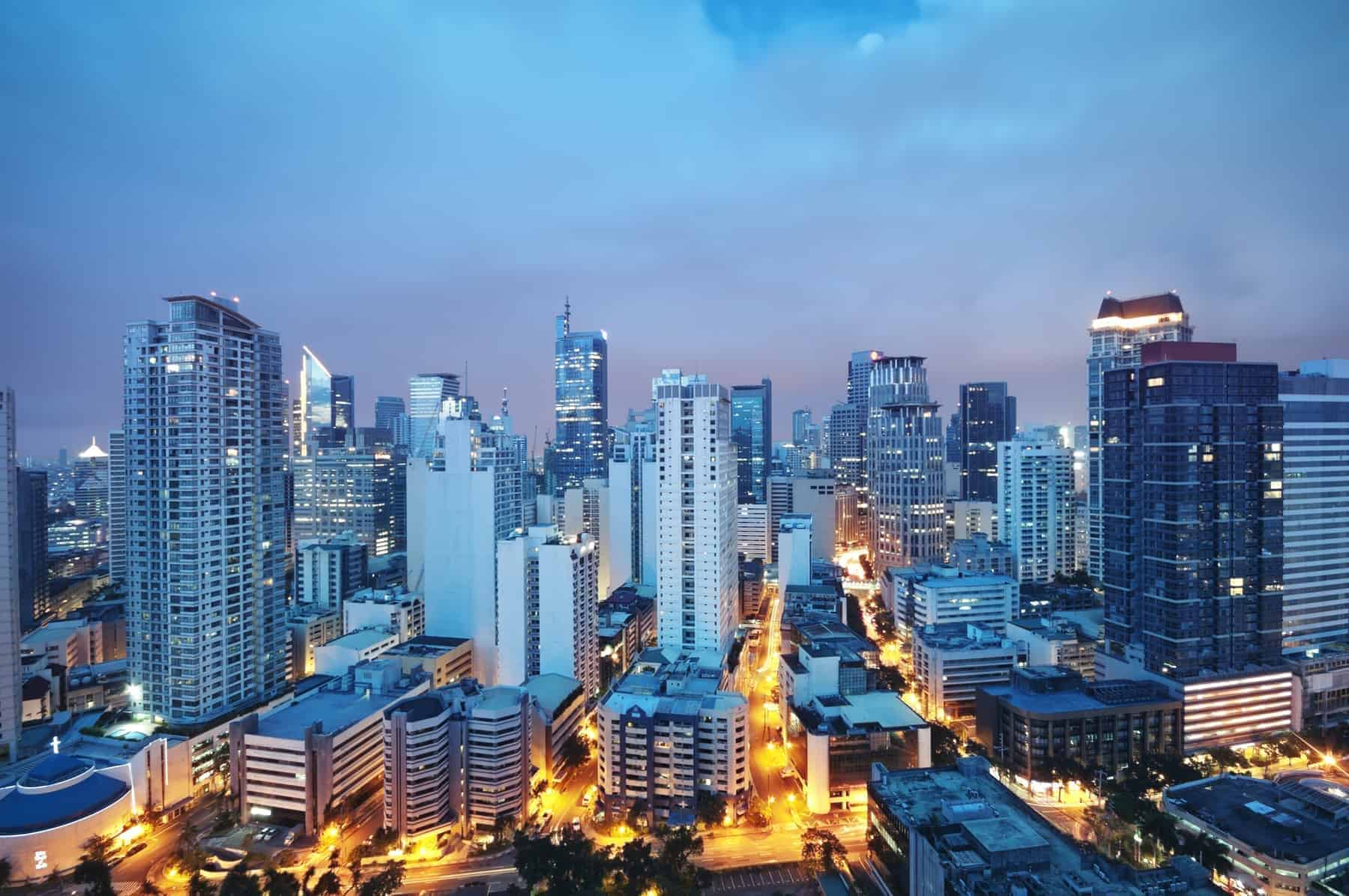Elevated, night view of Makati, the business district of Metro Manila. Luzon.
