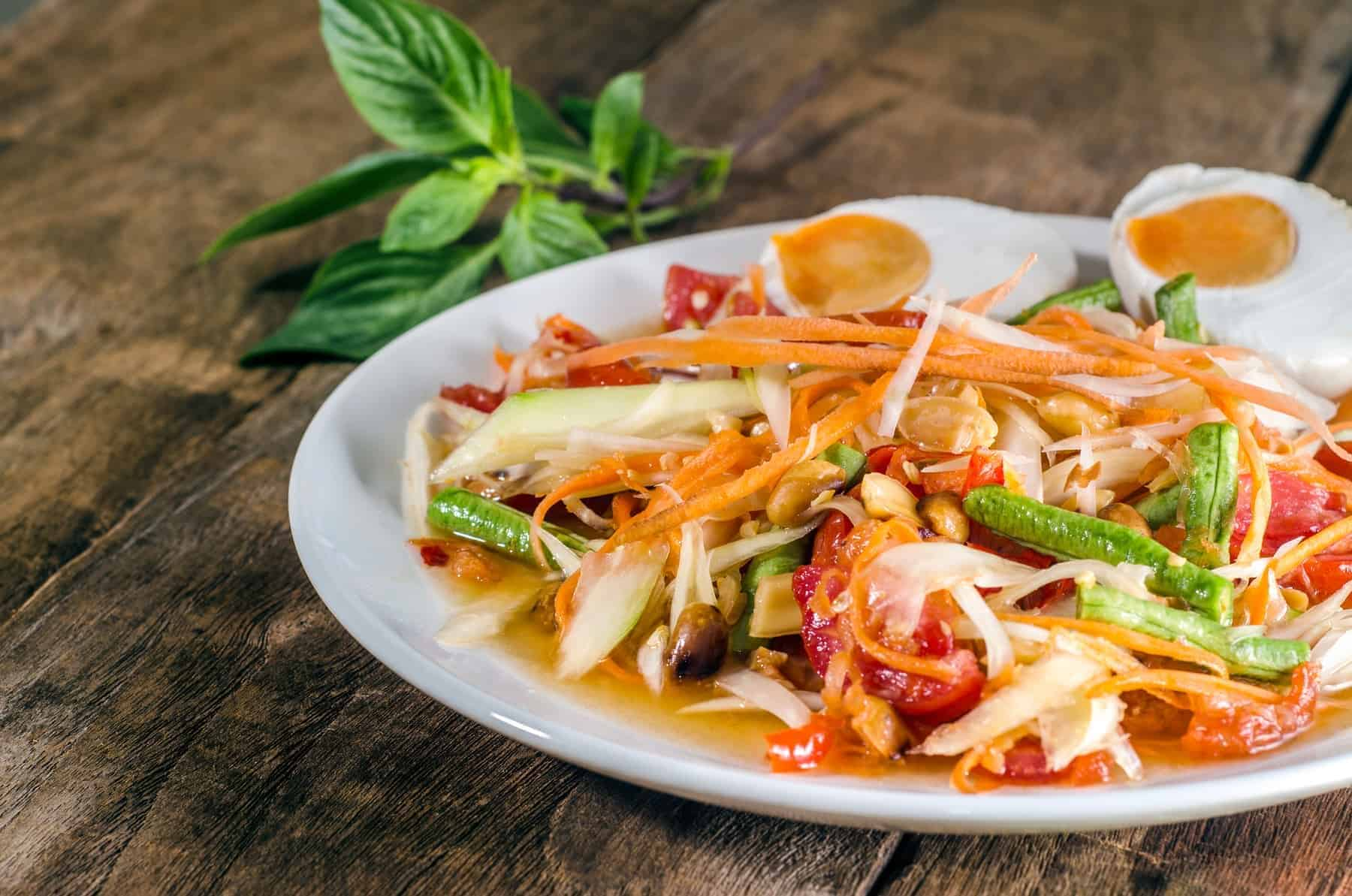Papaya salad spicy salted eggs at a food stand   Thailand