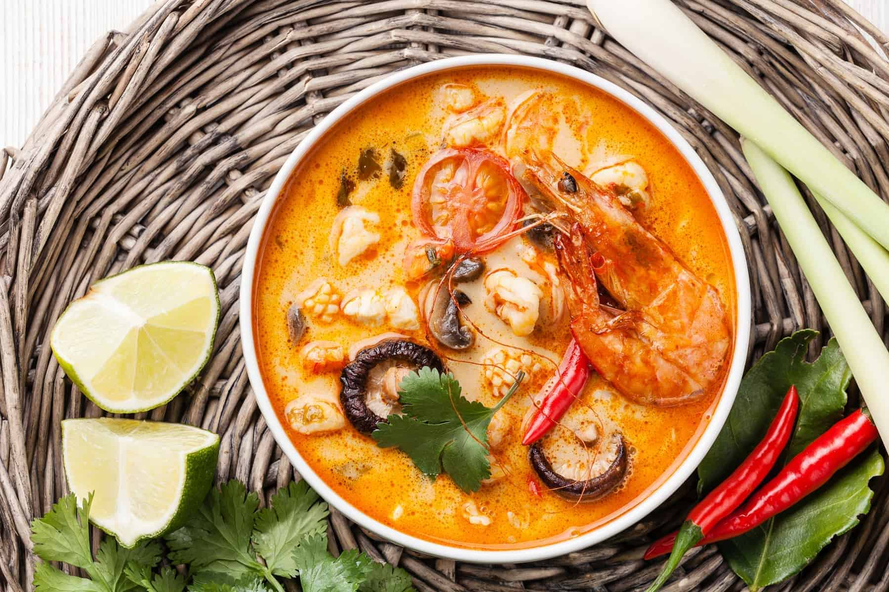 Spicy Thai soup Tom Yum with Coconut milk, Chili pepper and Seafood