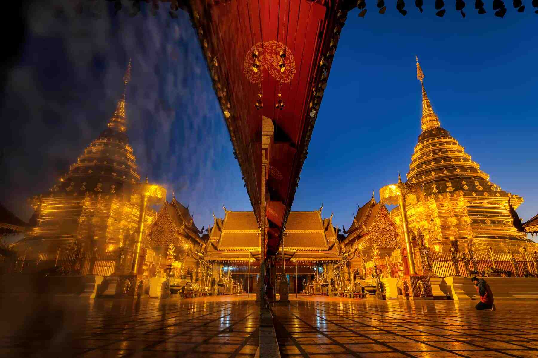 Wat phra that doi suthep temple in Chiang mai thailand, the most famous temple at twilight. Beautiful Pagoda with reflection.