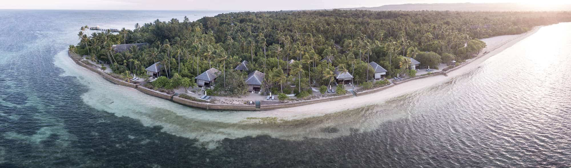 A remote resort is built on a idyllic island off the coast of Sulawesi in Indonesia. The Wakatobi resort is a favorite for scuba divers, snorkelers, and kite boarders due to its surrounding reefs and seasonal winds.