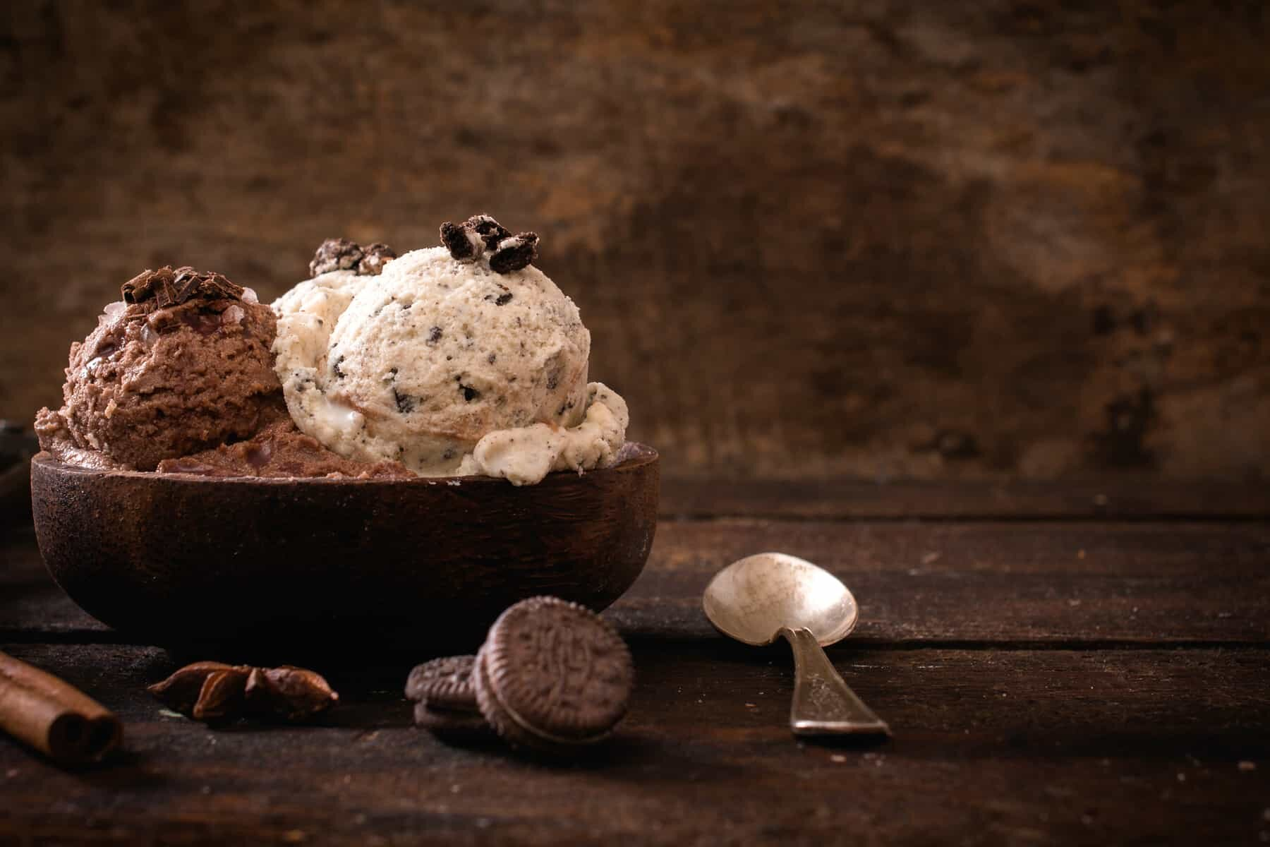 Italian food. Chocolate and stracciatella ice creams in a wooden bowl