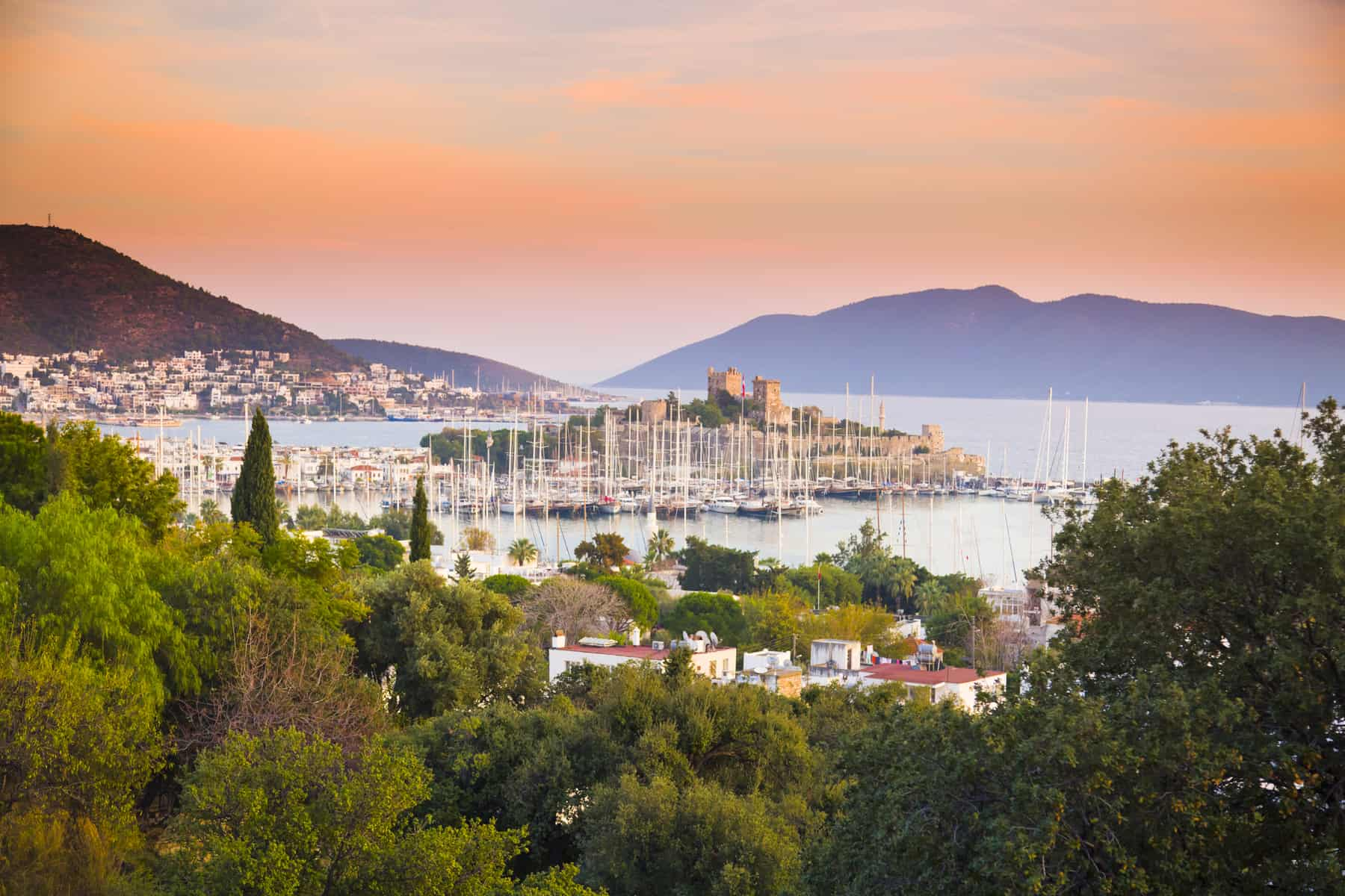 Sunset scene in Bodrum with the view of the ancient Bodrum Castle or the Castle of St Peter, Turkey